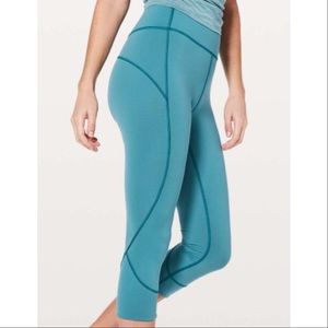 "LULULEMON IN MOVEMENT 19"" EVERLUX TEAL CROP SIZE 4"